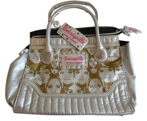 Betseyville by Betsey Johnson Faces Gold Satchel in Silver