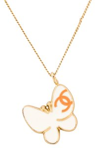 Chanel Gold-tone Chanel interlocking CC butterfly pendant necklace