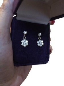 Especially designed and made 1 and 1/2 carat yellow gold diamond earrings. 1 .50 CTW 14K yellow gold diamond earrings.