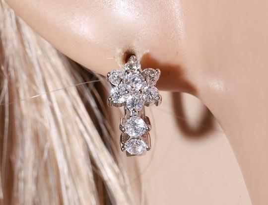 Other CZ Floral Studded Huggie Silver Rhodium Earrings