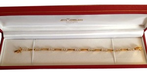 Gold-plated sterling silver with white sapphire settings bracelet
