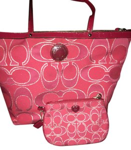 Coach Wristlet in Dark pink with silver