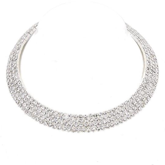 Preload https://img-static.tradesy.com/item/20114524/crystals-and-rhinestones-silverrhodium-four-row-statement-necklace-0-1-540-540.jpg