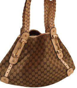Beautiful never been used gucci bag! It has leather braided handles ! Its great wih jeans and casual and even for evening! Tote in Ivory With Brown