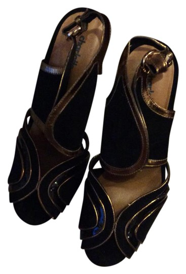 Preload https://img-static.tradesy.com/item/20118055/charlotte-russe-black-and-gold-sandals-platforms-size-us-8-regular-m-b-0-2-540-540.jpg