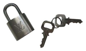 Louis Vuitton #323 BRUSHED TITANIUM. One of a kind . Authentic Lock And Key Sets