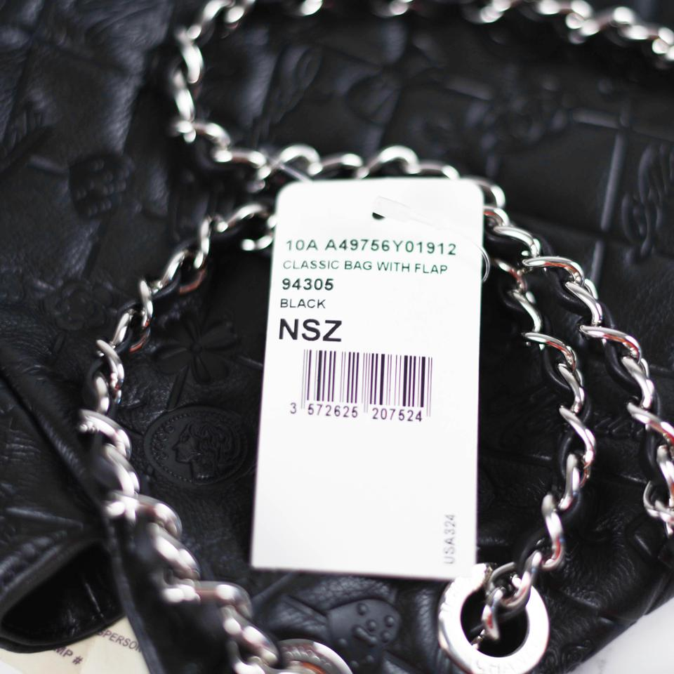 Chanel maxi lucky charms symbols cc logo flap embossed black chanel maxi lucky charms symbols cc logo flap embossed black leather shoulder bag biocorpaavc Image collections