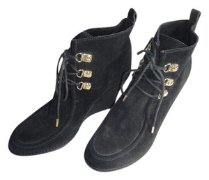 C. Wonder Tory Burch Black Boots