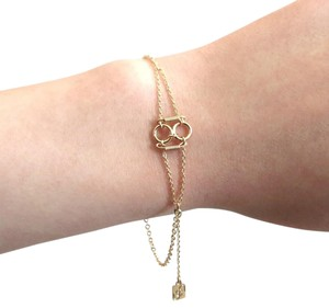 Elliot Francis Edgy gold charms and gears bracelet