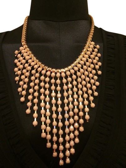 Preload https://item4.tradesy.com/images/gold-beige-statement-necklace-2012593-0-0.jpg?width=440&height=440