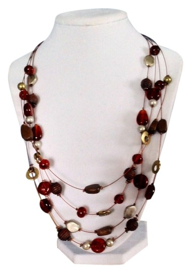 Preload https://img-static.tradesy.com/item/2012958/christopher-and-banks-brown-necklace-0-0-540-540.jpg