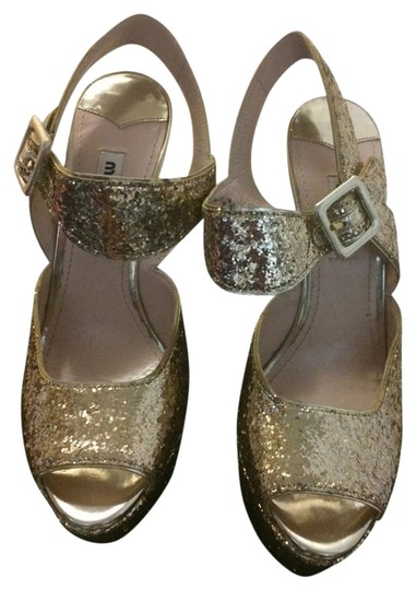 Preload https://item1.tradesy.com/images/miu-miu-gold-glitter-evening-sandals-formal-shoes-size-us-7-regular-m-b-2013350-0-1.jpg?width=440&height=440