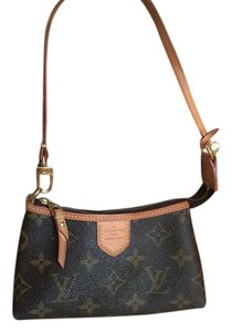 Louis Vuitton Leather cambas Clutch