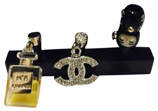 Preload https://img-static.tradesy.com/item/20137776/chanel-gold-silver-black-three-piece-set-of-cell-phone-charms-tech-accessory-0-1-540-540.jpg