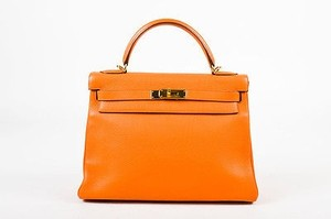 Hermès Gold Tone Clemence Leather Kelly Retourne 32cm Satchel in Orange
