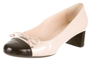 Prada Cream and Black Pumps