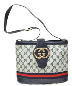 Gucci Bold Gold Accents Bucket High-end Bohemian Britt Blondie Style Midnight Blue-black Satchel in navy blue large G logo print coated canvas and leather