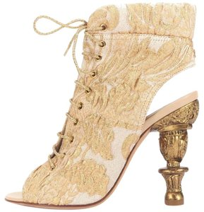Chanel Gold Boots
