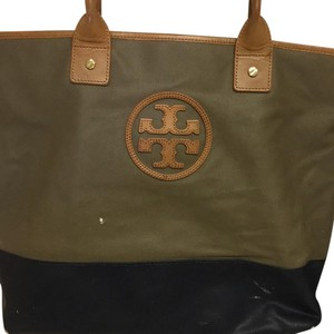 Gently worn Tory Burch tote. Dark camel top with navy bottom with TB logo. Tote in Tan