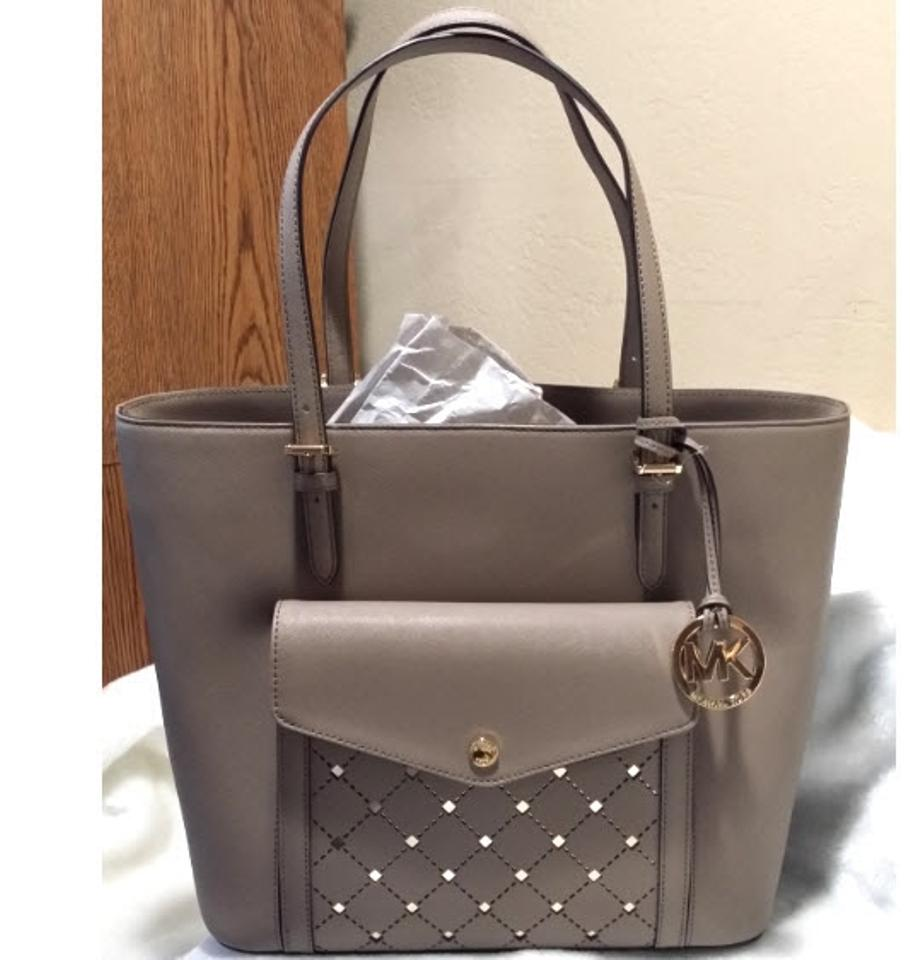 c37b52028bf2 Michael Kors Jet Set Item East West Snap Pocket Jet Set Travel Tote in dark  taupe. 12345678910