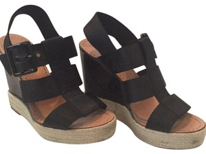 Coach Black upper with natural color weave around the base Wedges
