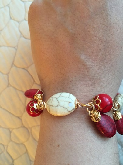 Unknown Red and tan stone gold bracelet.