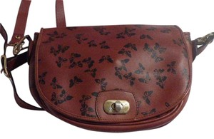 Bottega Veneta Mint Vintage Rare Dressy Or Casual Two-way Style High-end Bohemian Satchel in Embossed black butterfly print on rust brown colored leather