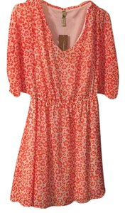 Francesca's short dress Orange/peach and white floral pattern on Tradesy