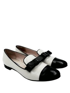 Prada Ivory and Black Flats