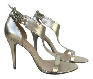 Guess Heels Gold Pumps