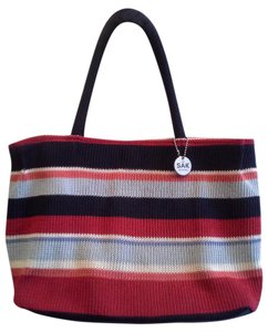 The Sak Tote in Red, blues, orange, multicolor