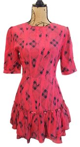 Sam & Lavi short dress Red Ruffle Mini Plaid Geometric Fitted on Tradesy