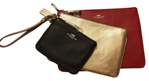 Coach Wristlet in Red Gold Black