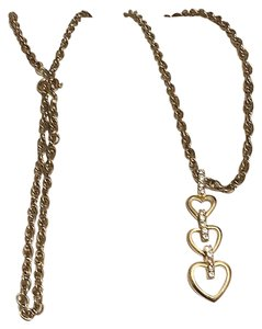 Nina Ricci Nina Ricci Gold Tone Pave Crystal Triple Heart Necklace Pendant