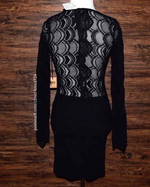 Free People short dress Black Bodycon Party Cocktail Formal Wedding Guest Long Sleeve Mini Classy on Tradesy