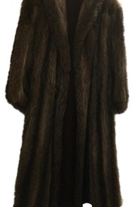 Beautiful raccoon coat full length with a tear in one sleeve. Selling as is Fur Coat