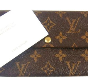 Louis Vuitton Monogrammed Leather Sarah clutch Wallet France