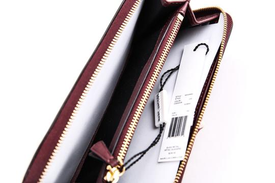 Marc Jacobs * Bow Flap Continental Burgundy Leather Zippered Wallet