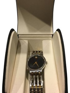 Movado men watch black dial two tone watch with dismond stones has two extra links in original box Movado men watch