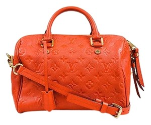 Louis Vuitton Leather Monogram Empreinte Speedy Bandouliere 25 Satchel in Red
