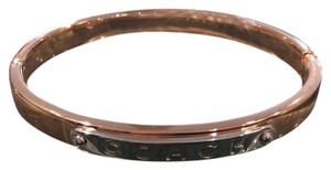 Coach Coach rose gold snap bangle