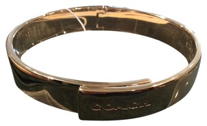 Coach Gold coach fold over bangle