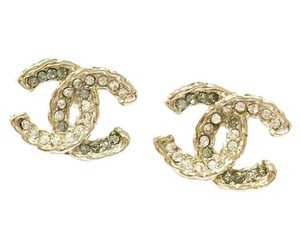 Chanel Chanel Light Gold Twisted CC Shiny Rhinestone Piercing Earrings