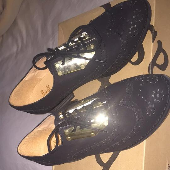 ShoeDazzle Black Wingtip Suede Like Finish With Gold Metal Accents Flats