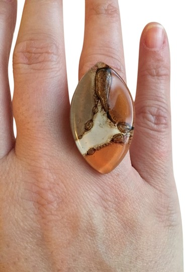 Unknown Light Brown, beige, coral ring.