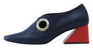 Rejina Pyo Leather Italian Navy upper with red heel Pumps