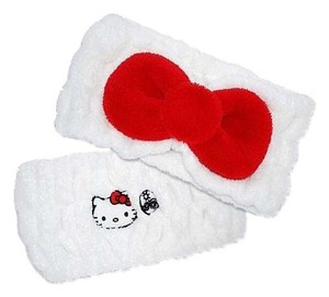 Sanrio New Hello kitty bow headband earth therapeutics NWOT head band
