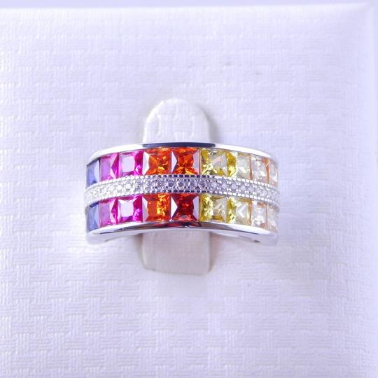 Preload https://img-static.tradesy.com/item/2021636/white-rainbow-sapphire-channel-set-wcz-accents-sterling-silver-ring-0-0-540-540.jpg