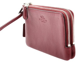 Coach Pebbled Leather Crossgrain Wristlet in Burgundy
