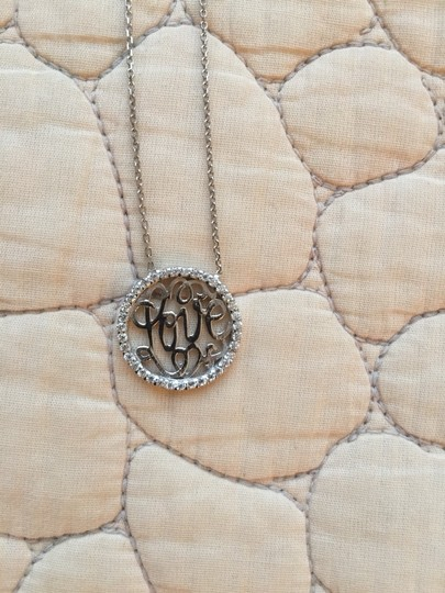 Unknown Pave studded love pendant silver necklace.